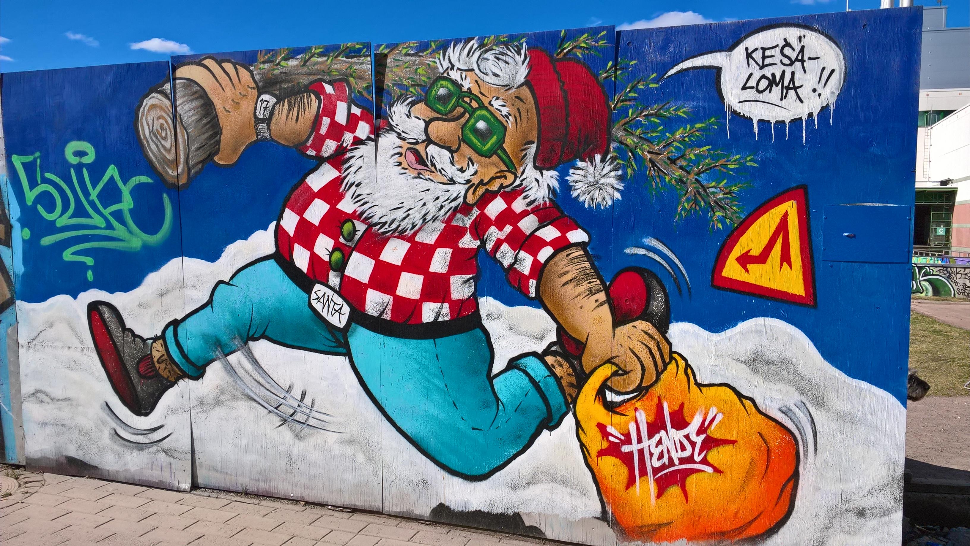 Vantaan kaupunki on tarjonnut graffitien tekoa varten maalauspintaa. Joulupunkin lomakuva maalattiin Myyrmäen luvalliseen graffiti-seinään. (Kuva: Jyrki Vättö)